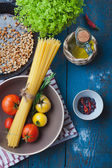 Ingredients for cooking italian pasta, Mediterranean cuisine — Stock Photo