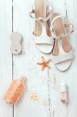 Summer women's accessories - sandals, sea salt, pumice stone and — Stock Photo