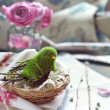 Easter decoration - bird in a nest with lace, pink roses and wil — Stock Photo #65654903