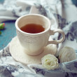 Cup of tea set with a beautiful tea towel and roses on a wooden  — ストック写真 #66640809