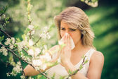 Woman with pollen allergy in springtime — Stock Photo