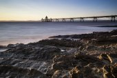 Long exposure landscape image of pier at sunset in Summer — Stock Photo