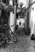 Typical old Mediterranean alley between old houses with bike abn — Stock Photo