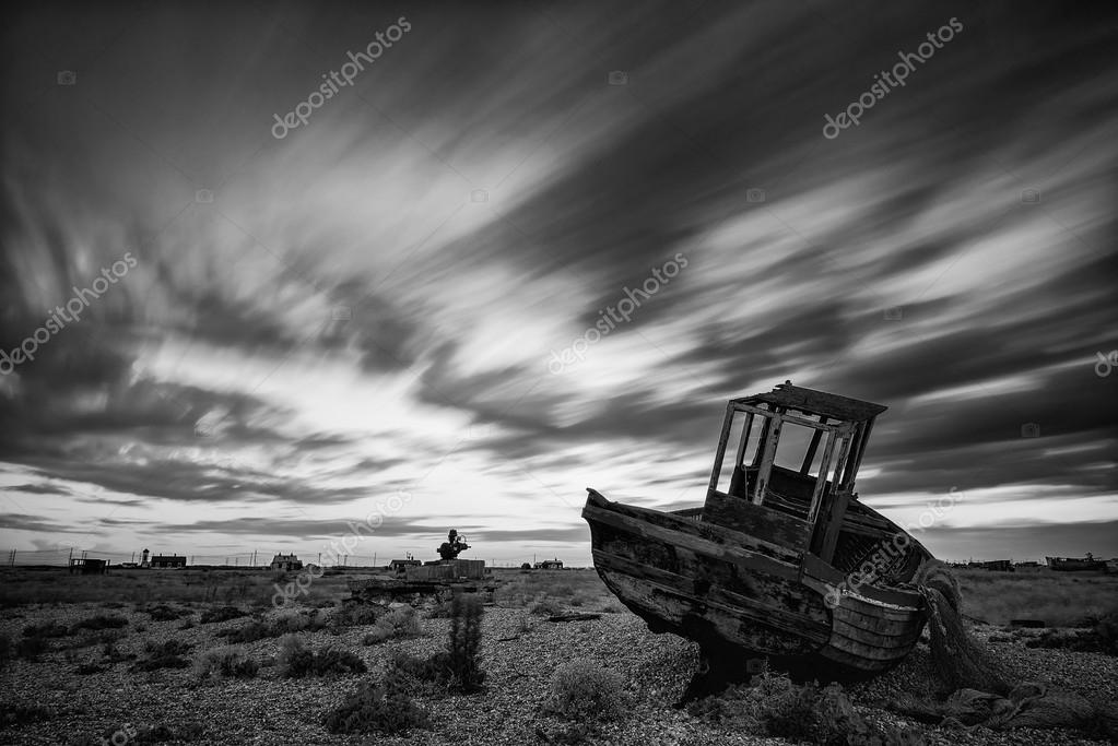 Black And White Photography Beach Landscapes Abandoned Fishing Boat on Shingle Beach Landscape at Sunset Black And White