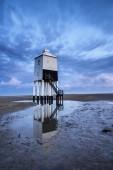 Beautiful landscape sunrise stilt lighthouse on beach — Stock Photo