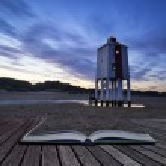 Beautiful landscape sunrise stilt lighthouse on beach conceptual — Stock Photo #59698335