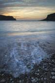 Stunning vibrant sunrise landscape over Lulworth Cove Jurassic C — Stock Photo