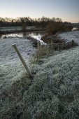 Landscape Winter surnise of river and frosty fields — Stock Photo