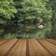 Landscape long exposure of river flowing through lush green fore — Stock Photo #64381363
