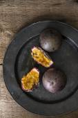 Passion fruit in moody natural light setting with vintage retro  — Stock Photo