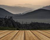 View along misty valley towards Snowdonia mountains with wooden  — Stock Photo