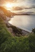 Beautiful vibrant sunrise over Mupe Bay landscape on Summer morn — Stock Photo