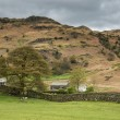 Lake District landscape with stormy sky over countryside anf fie — Stock Photo #77185471