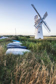 Stunning landscape of windmill and river at dawn on Summer morni — Stock Photo