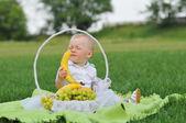 Child sniffing banana — Stock Photo