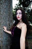 Pretty vampire near tree — Stock Photo
