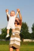 Happy mom with baby — Stock Photo