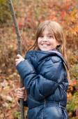 Pretty girl with stick — Stock Photo