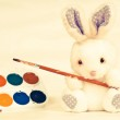 Toy rabbit with paints — Stock Photo #65031155