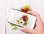 Hands taking photo milkshake with smartphone — Stock Photo