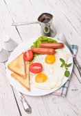 Breakfast with fried eggs. — Stock Photo
