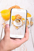 Hands taking photo breakfast with smartphone — Стоковое фото
