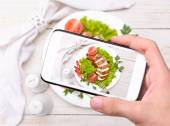 Hands taking photo chicken breast with smartphone. — Stock Photo