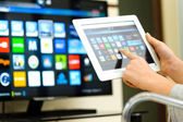Closeup of a tablet pc connected to a tv — Stock Photo