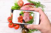 Hands taking photo raw meat with smartphone. — Stock Photo