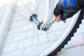 Repair of a bicycle with a wrench. — Stock Photo