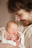 The newborn girl and her father — Stock Photo