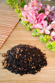 Blend of black tea on a table with colours3. — Stock Photo