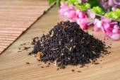Blend of black tea on a table with colours2. — Stock Photo