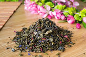 Blend of green tea on a table with colours4. — Stock Photo