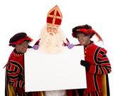 Sinterklaas i zwarte pieten z tablicy — Zdjęcie stockowe