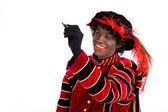 Zwarte Piet writing message ,Sinterklaas (black pete) — Stock Photo