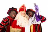 Sinterklaas and Zwarte Piet taking Selfie  — Stock Photo