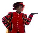 Black Pete showing object — Stock Photo