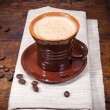 Cup of coffee on wooden table — Stock Photo #54268229