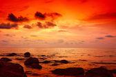 Dramatic sunset on the beach — Stock Photo