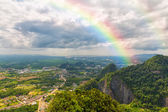 Beautiful landscape with a rainbow in the sky — Stock Photo