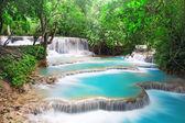 Waterfall in deep rain forest jungle — Stock Photo