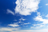 Bright beautiful blue sky with clouds, as background — Stock Photo