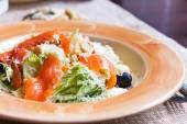 Caesar salad with salmon — Stock Photo