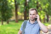 Young man using a smart phone — Stock Photo