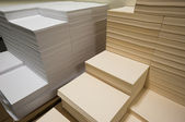 Stacks of white and beige paper — Stock Photo