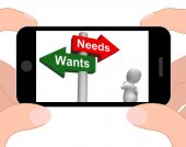 Wants Needs Signpost Displays Materialism Want Need — Stock Photo