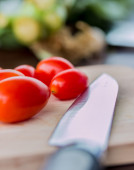 Tomatoes On Board Indicates Fresh Food And Cooking — Stock Photo