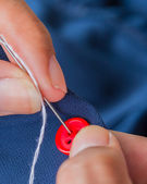 Sewing Button Means Stitchwork Textiles And Seamstress — Stock Photo