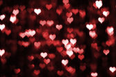 Abstract dark valentine background with red hearts — Stock Photo